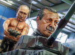 Two figures depicting Russia's President Vladimir Putin, left, and Turkish President Recep Tayyip Erdogan are shown during a press preview for the Mainz carnival, in Mainz, Germany, Tuesday, Feb. 18, 2020. (AP Photo/Michael Probst)