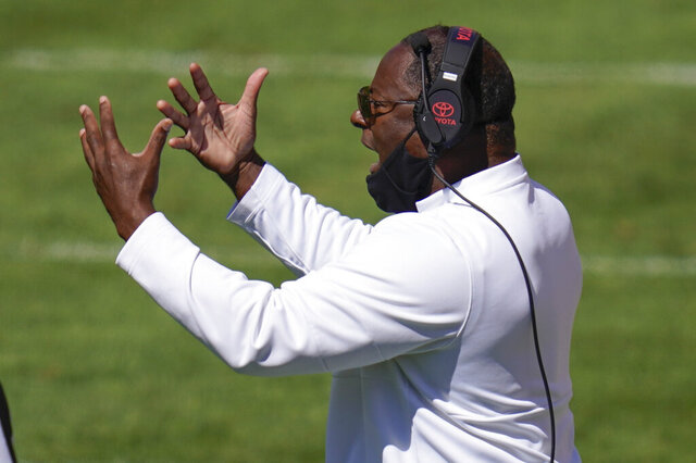 Syracuse head coach Dino Babers calls out to his team during the first half of an NCAA college football game against Pittsburgh, Saturday, Sept. 19, 2020, in Pittsburgh. Pittsburgh won 21-10. (AP Photo/Keith Srakocic)