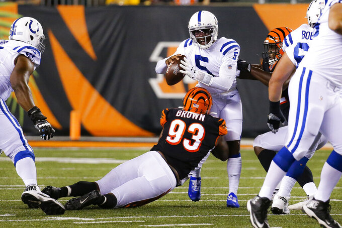 Indianapolis Colts quarterback Phillip Walker (5) is sacked by Cincinnati Bengals defensive tackle Andrew Brown (93) during the second half of an NFL preseason football game Thursday, Aug. 29, 2019, in Cincinnati. (AP Photo/Frank Victores)