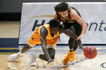 California forward Kuany Kuany, left, reaches for the ball under Arizona State guard Holland Woods during the first half of an NCAA college basketball game in Berkeley, Calif., Thursday, Dec. 3, 2020. (AP Photo/Jeff Chiu)