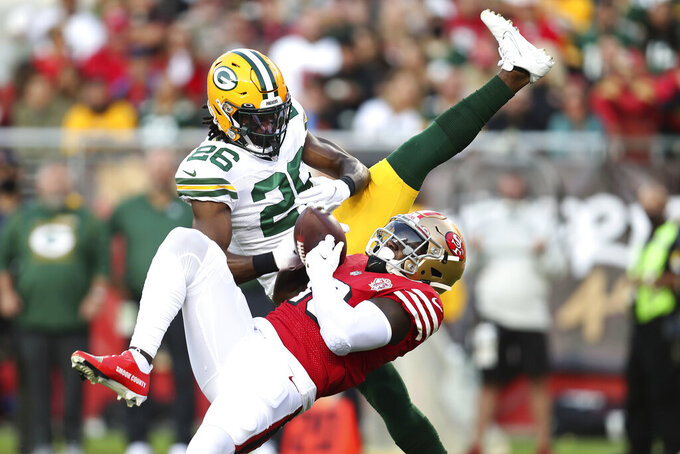 Green Bay Packers free safety Darnell Savage, top, defends a pass intended for San Francisco 49ers wide receiver Deebo Samuel during the first half of an NFL football game in Santa Clara, Calif., Sunday, Sept. 26, 2021. (AP Photo/Jed Jacobsohn)