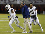 Georgia Tech head coach Paul Johnson sends in quarterback Tobias Oliver (8) with a play during the first half of an NCAA college football game against Virginia Tech, in Blacksburg, Va., Thursday, Oct. 25, 2018. (AP Photo/Steve Helber)