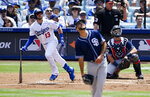 Los Angeles Dodgers' Max Muncy, left, runs to first as he hits a solo home run while San Diego Padres starting pitcher Joey Lucchesi, center, watches along with catcher Austin Hedges during the second inning of a baseball game Sunday, July 7, 2019, in Los Angeles. (AP Photo/Mark J. Terrill)