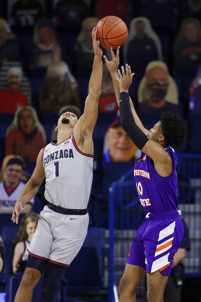 Gonzaga guard Jalen Suggs (1) blocks a shot by Northwestern State guard Jairus Roberson (10) during the second half of an NCAA college basketball game in Spokane, Wash., Tuesday, Dec. 22, 2020. Gonzaga won 95-78. (AP Photo/Young Kwak)