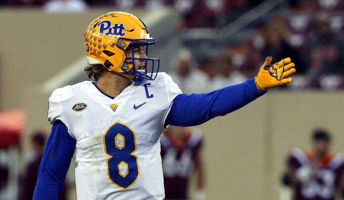 Pittsburgh quarterback Kenny Pickett (8) signals a first down during a fourth quarter drive of an NCAA college football game against Virginia Tech, Saturday, Oct. 16, 2021, in Blacksburg, Va. (Matt Gentry/The Roanoke Times via AP)