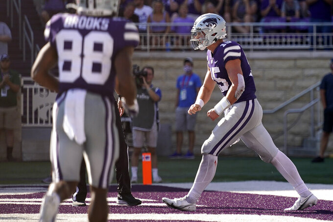 Kansas State quarterback Will Howard (15) celebrates after running for a touchdown during the second half of an NCAA college football game against Nevada Saturday, Sept. 18, 2021, in Manhattan, Kan. (AP Photo/Charlie Riedel)