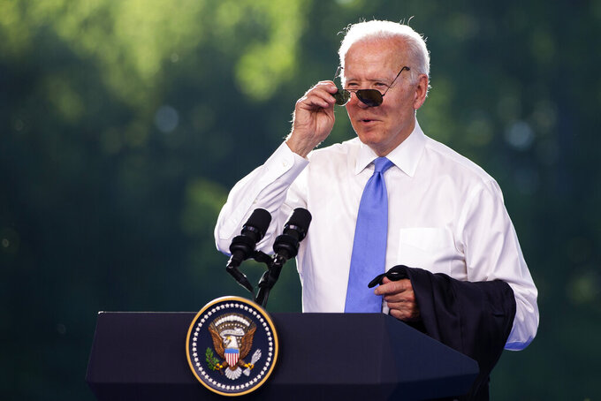 US president Joe Biden puts on his sunglasses at the end of his closing press conference during the US - Russia summit in Geneva, Switzerland, Wednesday, June 16, 2021. (Peter Klaunzer/Keystone via AP, Pool)
