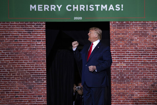 "FILE - In this Dec. 18, 2019, file photo, President Donald Trump speaks during a campaign rally at Kellogg Arena in Battle Creek, Mich. From foreign policy initiatives to the choice of music at White House events, from the prevalence of ""Merry Christmas"" greetings to the title of the new USMCA trade deal, Trump is happy to give himself a public pat on the back _ repeatedly _ for his great ideas. (AP Photo/ Evan Vucci, File)"