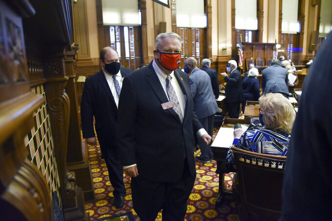 David Ralston, Speaker of the House, leaves after the session adjourned on the House Chambers during the second day of the 2021 legislative session at the Georgia State Capitol, Tuesday, Jan. 12, 2021, in Atlanta. (Hyosub Shin/Atlanta Journal-Constitution via AP)