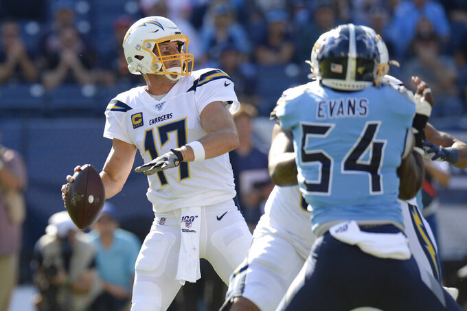 Los Angeles Chargers quarterback Philip Rivers (17) passes as he is pressured by Tennessee Titans inside linebacker Rashaan Evans (54) in the first half of an NFL football game Sunday, Oct. 20, 2019, in Nashville, Tenn. (AP Photo/Mark Zaleski)