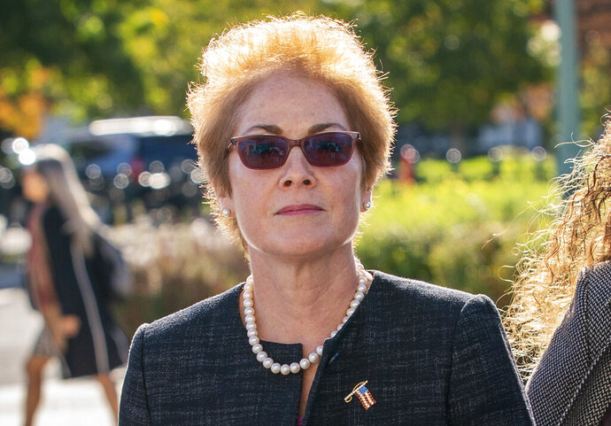FILE - In this Oct. 11, 2019, file photo, former U.S. ambassador to Ukraine Marie Yovanovitch, arrives on Capitol Hill in Washington. The House impeachment panels are starting to release transcripts from their investigation. And in one of them, Yovanovitch says that Ukrainian officials warned her in advance that Rudy Giuliani and his allies were planning to