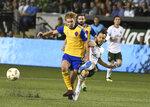 Colorado Rapids' Johan Blomberg (8) knocks the ball away from Portland Timbers' Sebastian Blanco (10) during an MLS soccer match Saturday, Sept. 8, 2018, in Portland, Ore. (Kent Frasure/The Oregonian via AP)
