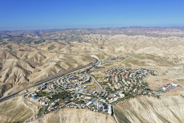 """FILE - This Jan. 26, 2020, file photo, shows a view of the West Bank Jewish settlement of Mitzpe Yeriho. The United Nations Human Rights Council released a list of more than 100 companies it says are operating in Israel's West Bank settlements. In a report Wednesday, Feb. 12, 2020, the council said the companies' activities """""""
