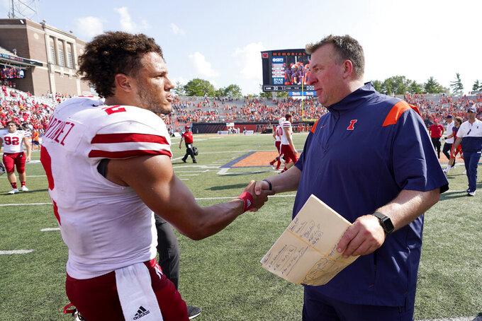 Nebraska quarterback Adrian Martinez, left, congratulates Illinois head coach Bret Bielema after an NCAA college football game Saturday, Aug. 28, 2021, in Champaign , Ill. Illinois won 30-22. (AP Photo/Charles Rex Arbogast)