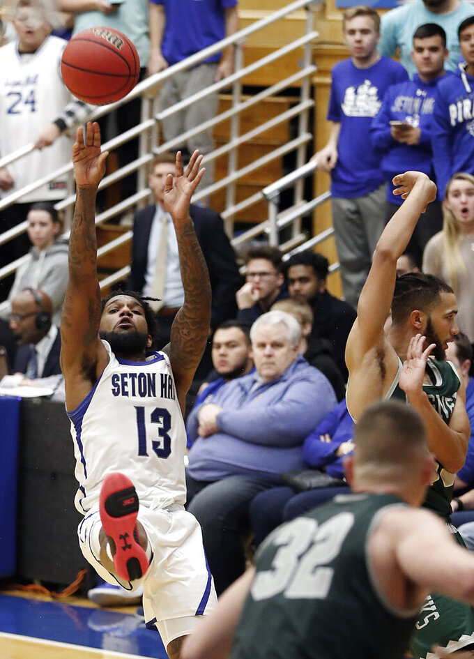 Seton Hall guard Myles Powell (13) shoots a 3-point shot after being fouled by Wagner guard Curtis Cobb III during the second half of an NCAA college basketball game Tuesday, Nov. 5, 2019, in South Orange, N.J. (AP Photo/Noah K. Murray)