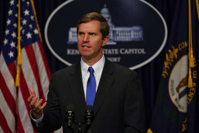 "FILE - In this Feb. 19, 2020 file photo Kentucky Gov. Andy Beshear speaks to the press at the Capitol in Frankfort, Ky. Beshear says protesters who hung an effigy of him were trying to use ""fear and terror"