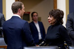 Chairwoman Rep. Maxine Waters, D-Calif., right, speaks with Facebook CEO Mark Zuckerberg after he testifies before a House Financial Services Committee hearing on Capitol Hill in Washington, Wednesday, Oct. 23, 2019, on Facebook's impact on the financial services and housing sectors. (AP Photo/Andrew Harnik)