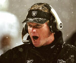 "File-Oakland Raiders head coach Jon Gruden shouts instructions during their overtime loss to the New England Patriots in an AFC Divisional playoff game in Foxboro, Mass. Saturday, Jan. 19, 2002.  Gruden says opening this season at Carolina and then playing New Orleans on made him feel like he was time warp. His nostalgia is even more amplified this week against New England. It's been nearly two decades since he walked out of a snow-covered Foxboro Stadium on the wrong end of a 16-13 overtime loss to the Patriots in the infamous ""tuck rule"" game during the 2001 playoffs. (AP Photo/Winslow Townson, File)"