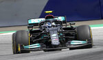 Mercedes driver Valtteri Bottas of Finland steers his car during the Styrian Formula One Grand Prix at the Red Bull Ring racetrack in Spielberg, Austria, Sunday, June 27, 2021. (AP Photo/Darko Vojinovic)