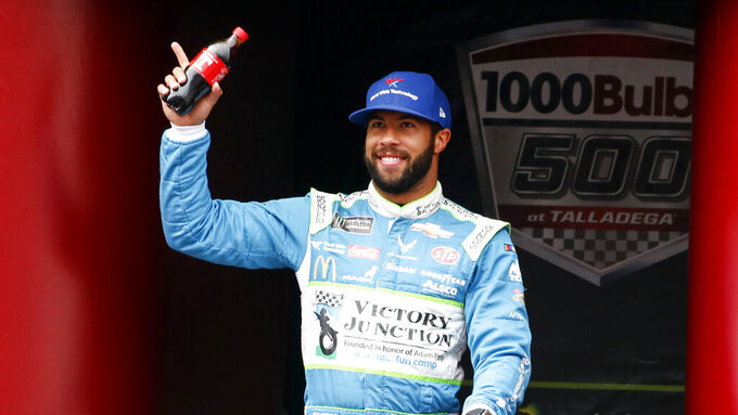 Monster Energy NASCAR Cup Series driver Bubba Wallace (43) waves at driver introductions during a NASCAR Cup Series auto race at Talladega Superspeedway, Sunday, Oct. 14, 2019, in Talladega, Ala. (AP Photo/Butch Dill)