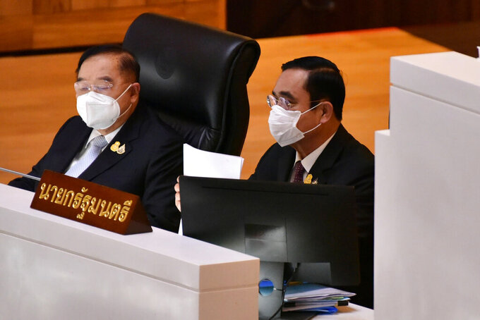 Thailand Deputy Prime Minister Prawit Wongsuwan, left, and Thailand's Prime Minister Prayuth Chan-ocha arrive at the parliament in Bangkok, Thailand, Tuesday, Aug. 31, 2021. Thai lawmakers on Tuesday began a no-confidence debate targeting Prayuth and five of his Cabinet members, with the opposition focusing on charges the government bungled its handling of the COVID-19 pandemic. (Public Relations Dpt. Lower House via AP)