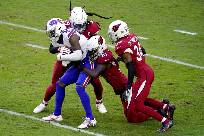 Buffalo Bills wide receiver Stefon Diggs (14) is tackled by Arizona Cardinals cornerback Patrick Peterson (21) and outside linebacker De'Vondre Campbell (59) during the first half of an NFL football game, Sunday, Nov. 15, 2020, in Glendale, Ariz. (AP Photo/Ross D. Franklin)