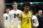 Michigan's Jordan Poole (2) walks off the court after the team's 65-60 loss to Michigan State in an NCAA college basketball championship game in the Big Ten Conference tournament, Sunday, March 17, 2019, in Chicago. (AP Photo/Kiichiro Sato)