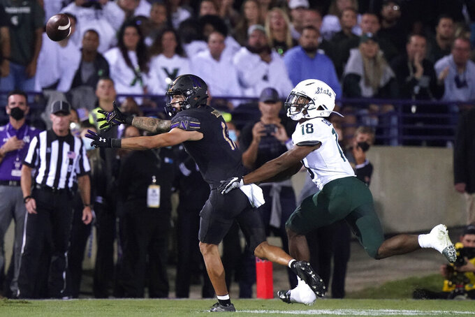 Northwestern wide receiver Bryce Kirtz, left, reaches in vain for a pass as Michigan State cornerback Kalon Gervin defends during the first half of an NCAA college football game in Evanston, Ill., Friday, Sept. 3, 2021. (AP Photo/Nam Y. Huh)
