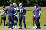 Dallas Cowboys linebacker Micah Parsons (11) talks with team staff as they run through drills during practice at the team's NFL football training facility in Frisco, Texas, Thursday, Sept. 23, 2021. (AP Photo/Tony Gutierrez)