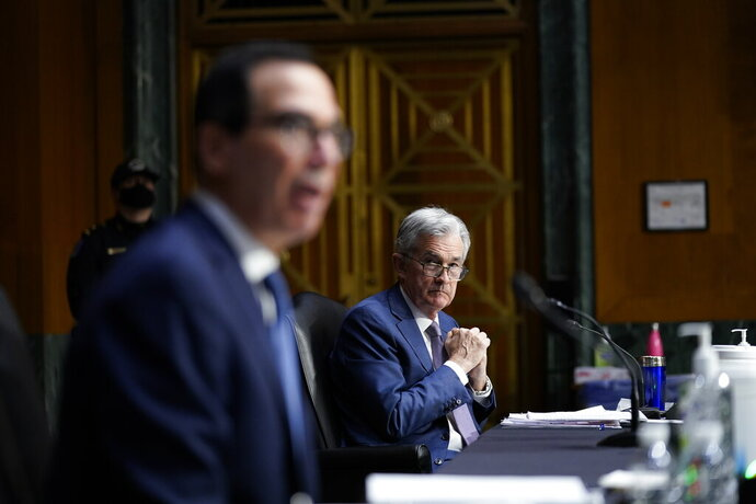 Chairman of the Federal Reserve Jerome Powell listens as Treasury Secretary Steven Mnuchin testifies during a Senate Banking Committee hearing on 'The Quarterly CARES Act Report to Congress' on Capitol Hill in Washington, Tuesday, Dec. 1, 2020. (AP Photo/Susan Walsh, Pool)