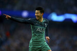 Tottenham's Son Heung-Min celebrates scoring during the Champions League quarterfinal, second leg, soccer match between Manchester City and Tottenham Hotspur at the Etihad Stadium in Manchester, England, Wednesday, April 17, 2019. (AP Photo/Dave Thompson)