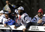 New England Patriots' Malcom Brown, left, Deatrich Wise Jr., center, and Lawrence Guy, right, ride a duck boat as the team parades through downtown Boston, Tuesday, Feb. 5, 2019, to celebrate their win over the Los Angeles Rams in Sunday's NFL Super Bowl 53 football game in Atlanta. (AP Photo/Steven Senne)