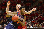 Arizona guard Dylan Smith, front, attempts to drive past Utah guard Parker Van Dyke, rear, during the first half of an NCAA college basketball game Thursday, Feb. 14, 2019, in Salt Lake City. (AP Photo/Alex Goodlett)