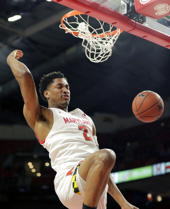 Maryland guard Aaron Wiggins dunks on Holy Cross during the first half of an NCAA college basketball game, Tuesday, Nov. 5, 2019, in College Park, Md. (AP Photo/Julio Cortez)