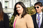 White House press secretary Sarah Sanders, left, walks with Deputy White House Press Secretary Hogan Gidley, right, to speak with reporters outside the West Wing of the White House in Washington, Monday, March 25, 2019. (AP Photo/Susan Walsh)