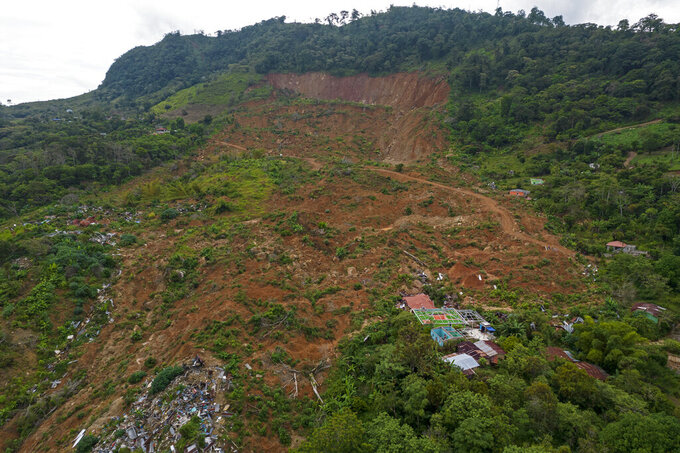 A bird's eye view of the Honduran hilltop community La Reina, seven months after it was buried by a mudslide triggered by the November 2020 Hurricanes Eta and Iota, Tuesday, June 29, 2021. To rebuild their houses and replant their crops, the villagers needed land -- much of which is in the hands of drug traffickers. (AP Photo/Rodrigo Abd)