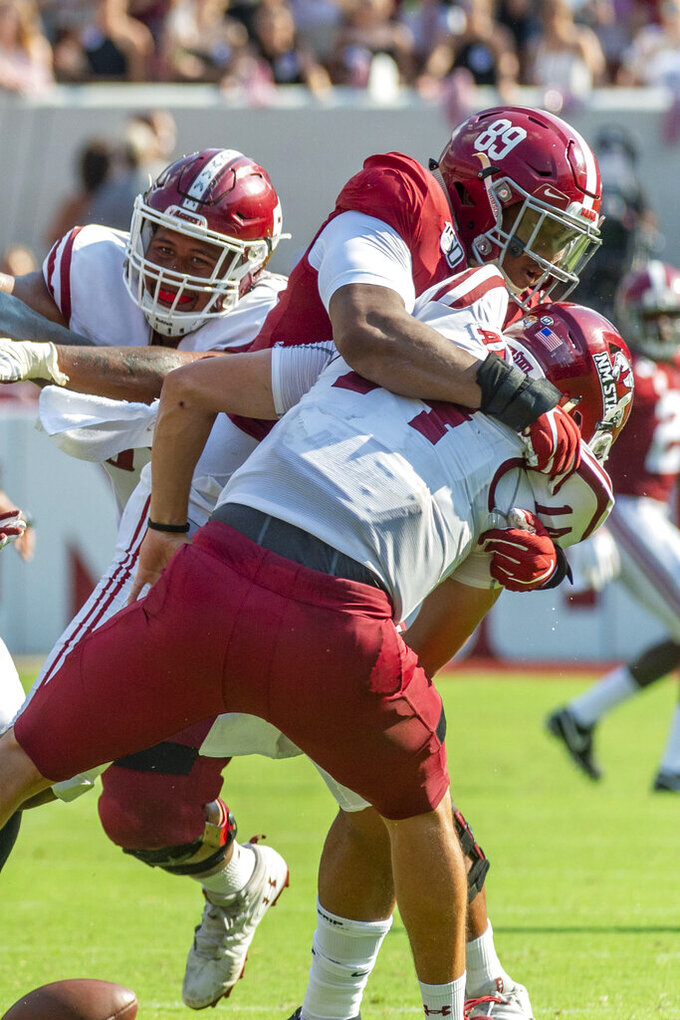 Alabama defensive lineman LaBryan Ray (89) hits New Mexico State quarterback Josh Adkins (14), causing a fumble, during the first half of an NCAA college football game Saturday, Sept. 7, 2019, in Tuscaloosa, Ala. (AP Photo/Vasha Hunt)
