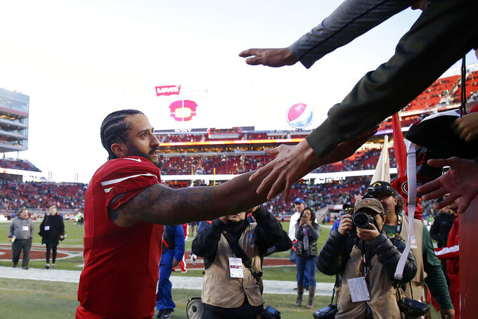 FILE - In this Jan. 1, 2017, file photo, San Francisco 49ers quarterback Colin Kaepernick greets fans after an NFL football game against the Seattle Seahawks in Santa Clara, Calif. It was his last game in the NFL.. (AP Photo/Tony Avelar, File)