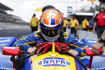 Alexander Rossi lowers himself into his car during practice for the Indianapolis 500 IndyCar auto race at Indianapolis Motor Speedway, Wednesday, May 15, 2019 in Indianapolis. (AP Photo/Michael Conroy)
