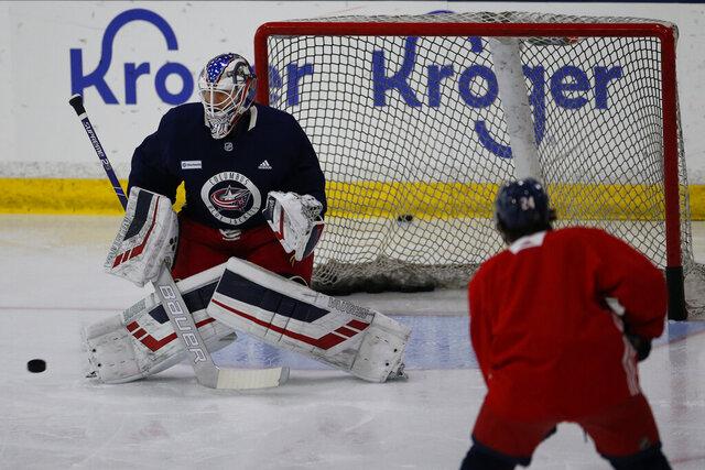 Columbus Blue Jackets' Joonas Korpisalo, of Finland, runs a drill during the NHL hockey team's practice Monday, July 20, 2020, in Columbus, Ohio. (AP Photo/Jay LaPrete)