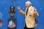Cliff Harris, a member of the Pro Football Hall of Fame Centennial Class, reacts during the induction ceremony at the Pro Football Hall of Fame, Saturday, Aug. 7, 2021, in Canton, Ohio. (AP Photo/Ron Schwane, Pool)