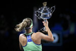 Sofia Kenin of the U.S. holds the Daphne Akhurst Memorial Cup aloft after defeating Spain's Garbine Muguruza in the women's singles final at the Australian Open tennis championship in Melbourne, Australia, Saturday, Feb. 1, 2020. (AP Photo/Dita Alangkara)
