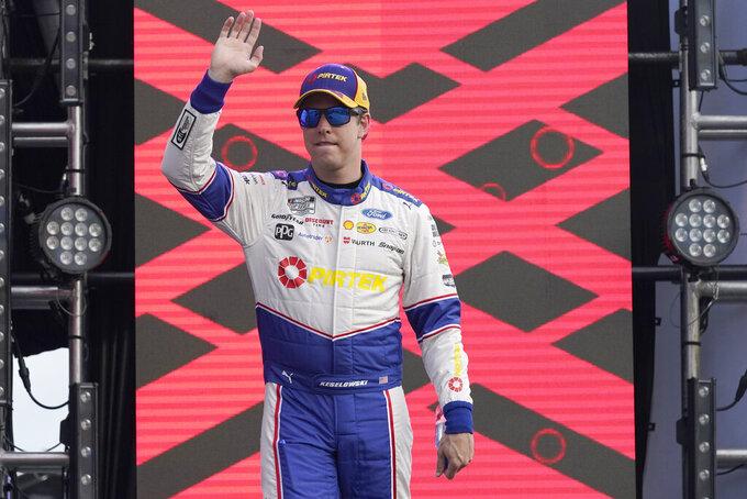 Brad Keselowski waves to fans during driver introductions before the NASCAR Cup Series auto race at Daytona International Speedway, Saturday, Aug. 28, 2021, in Daytona Beach, Fla. (AP Photo/John Raoux)