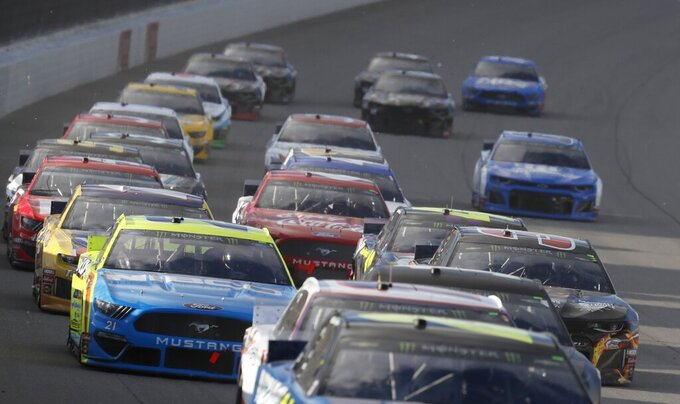Drivers take the first turn at the NASCAR cup series auto race at Michigan International Speedway, Monday, June 10, 2019, in Brooklyn, Mich. (AP Photo/Carlos Osorio)