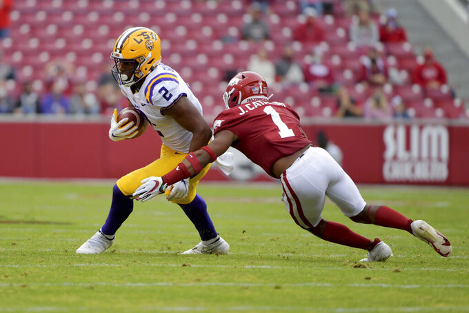 "File-This Nov. 21, 2020, file photo shows LSU tight end Arik Gilbert against Arkansas during an NCAA college football game in Fayetteville, Ark.  Florida landed one of the country's most coveted transfers Sunday, Jan. 31, 2021,  a likely replacement for star tight end Kyle Pitts. Former LSU standout Gilbert committed to the Gators on Twitter, saying ""this is the best situation for me and I'm excited to join the family."" (AP Photo/Michael Woods, File)"