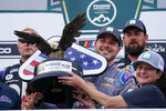 Alex Bowman, center, driver of car 48, celebrates with his crew after winning the NASCAR Cup Series auto race at Pocono Raceway, Saturday, June 26, 2021, in Long Pond, Pa. (AP Photo/Matt Slocum)