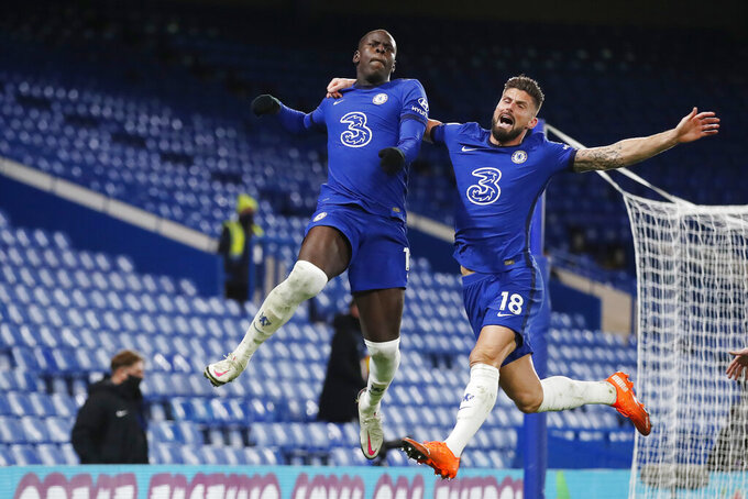 Chelsea's Kurt Zouma, left, celebrates with Olivier Giroud, after scoring their side's second goal during the English Premier League soccer match between between Chelsea and Leeds United at Stamford Bridge in London, England, Saturday, Dec. 5, 2020. (Matthew Childs/Pool via AP)
