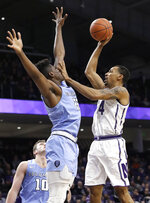 Northwestern guard Ryan Taylor, right, shoots against Columbia forward Ike Nweke during the second half of an NCAA college basketball game Sunday, Dec. 30, 2018, in Evanston, Ill. Northwestern won 75-54. (AP Photo/Nam Y. Huh)