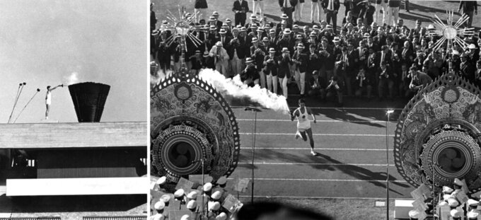Japanese runner Yoshinori Sakai runs with the Olympic torch to light the cauldron, right, during the opening ceremonies of the Summer Olympics in Tokyo, Oct. 10, 1964. (AP Photo)