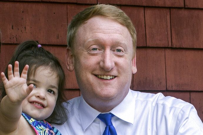 Dan Feltes holds his youngest daughter, Josie, on Wednesday, Aug. 12, 2020, at his home in Concord, N.H. Feltes is seeking the Democratic gubernatorial nomination in the Tuesday, Sept. 8, primary election. (Geoff Forester/The Concord Monitor via AP